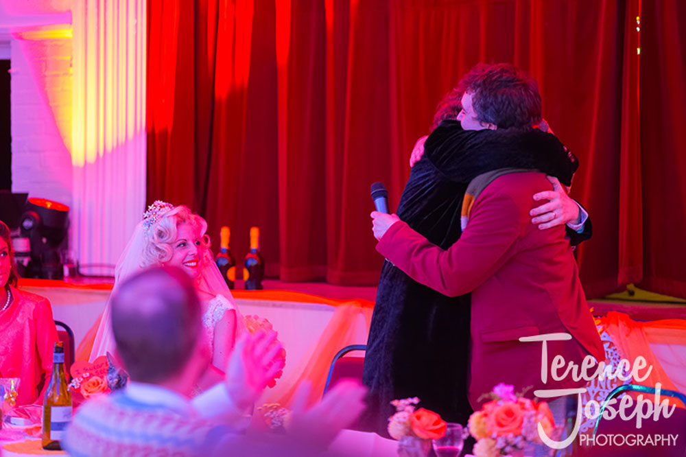 Groom hugging the guests