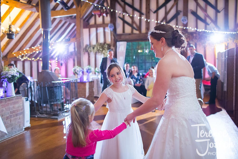 Bride having dance with kids at Vintage wedding