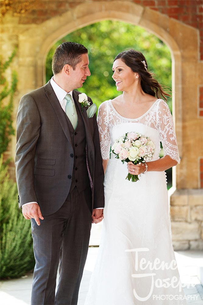 Archway wedding portraits at Oakwood House in Maidstone
