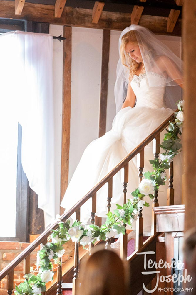 The bride walks down the stairs