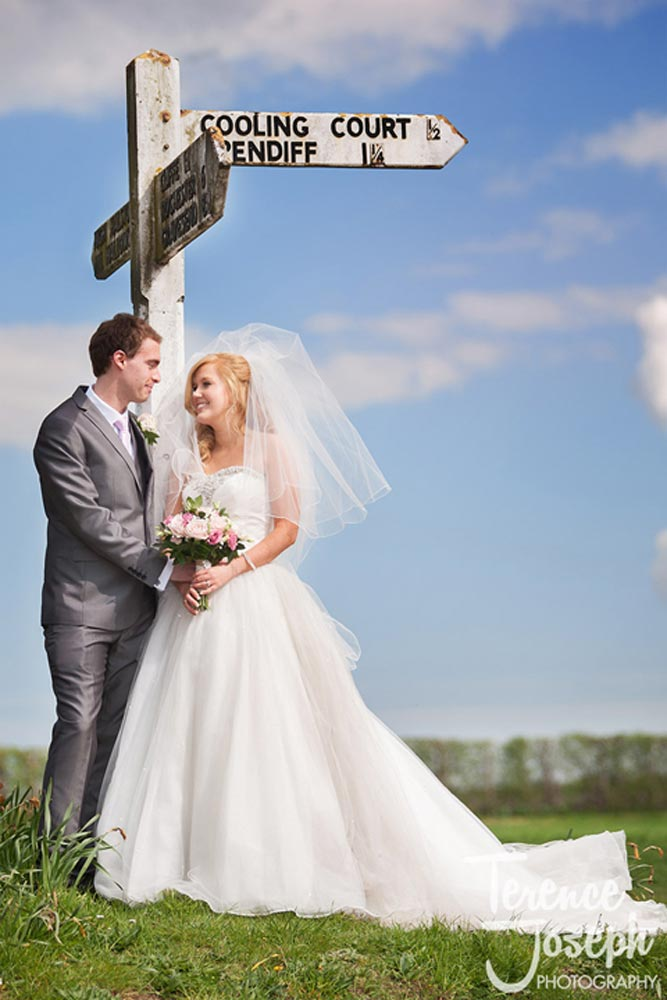 Wedding couple photos near Cooling Castle road sign
