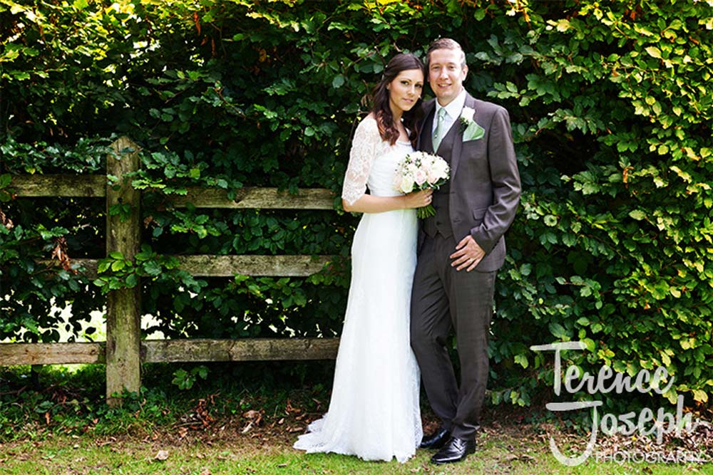 Beautiful bride and groom outdoor wedding photos at Oakwood House in Maidstone
