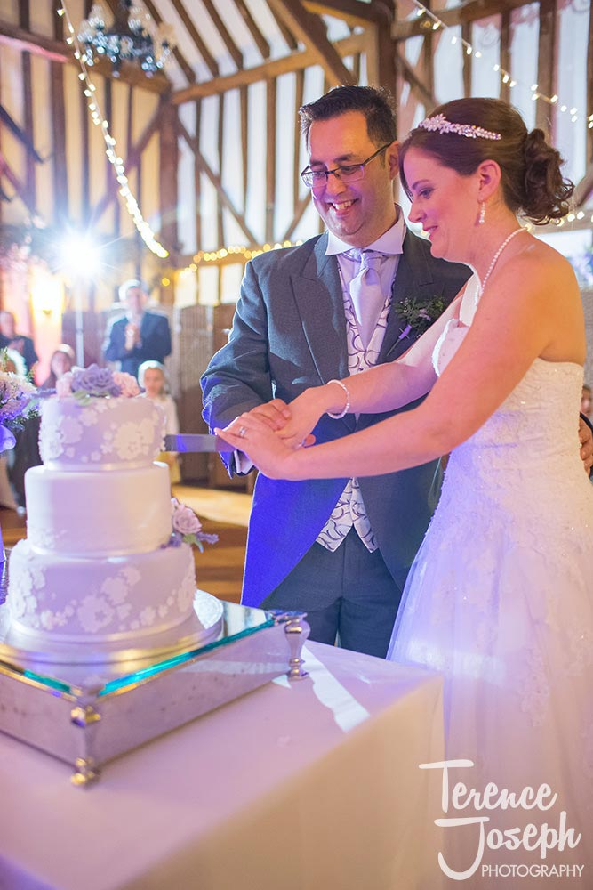 Bride and groom cut the wedding cake at The Plough at Leigh