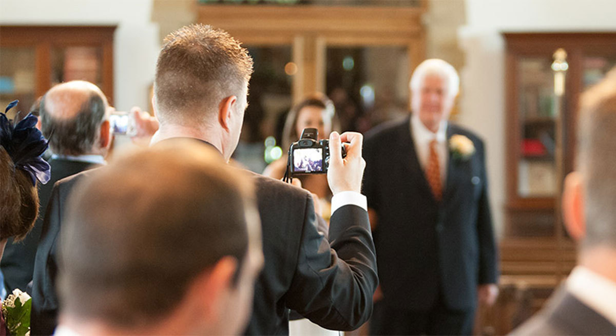 How can your guests enjoy your wedding ceremony if they have their head stuck behind their camera? By Terence Joseph Photography