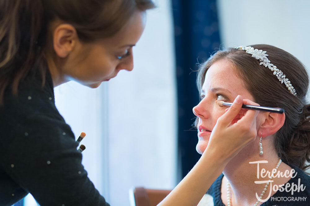 Bride getting ready for wedding ceremony by Terence Joseph Photography