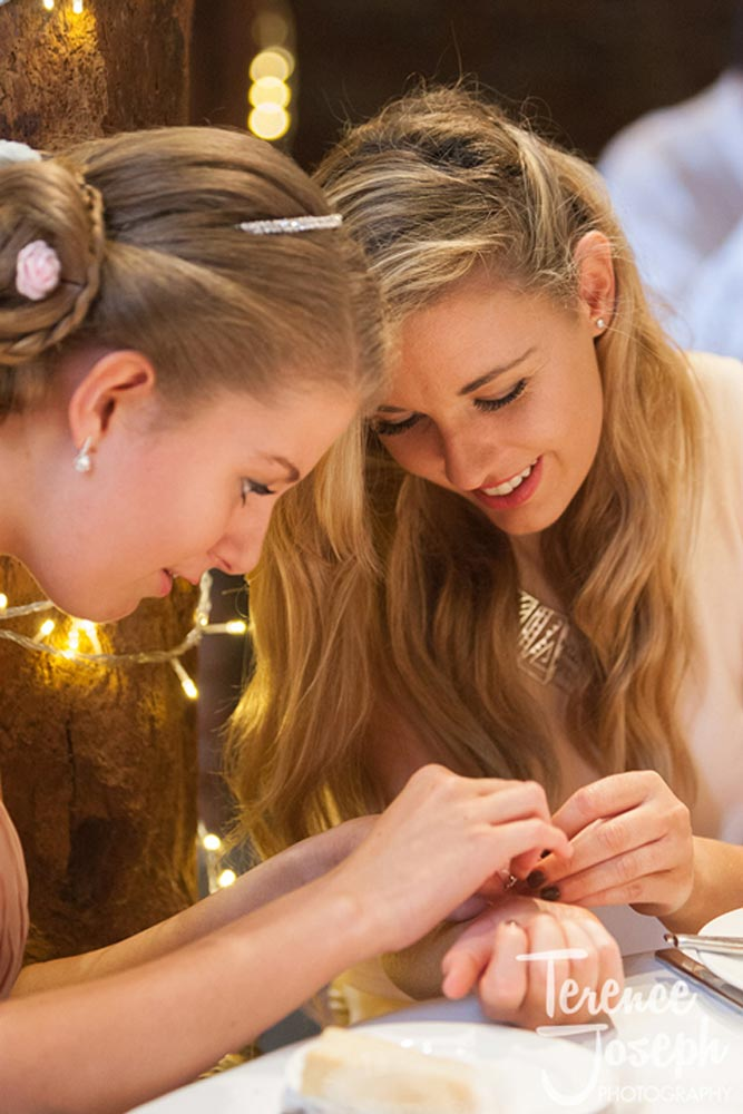 Wedding sisters fixing their jewellery