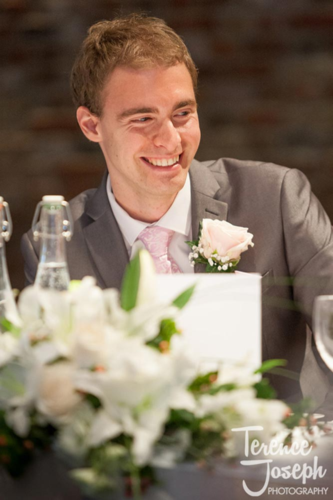 Happy groom during the speeches
