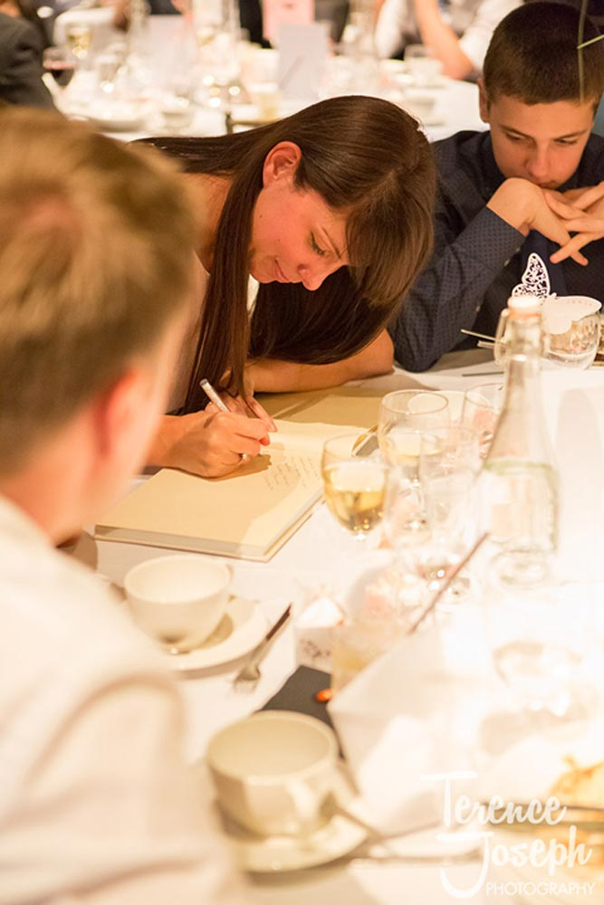 Guests writing notes to the newly weds