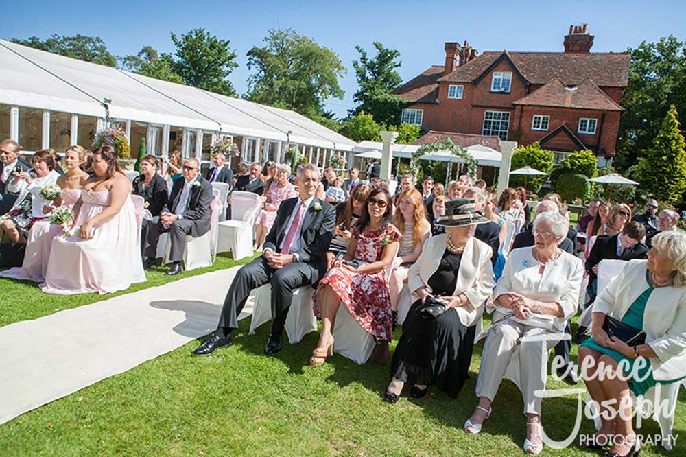 Wedding guests seated at outdoor wedding ceremony