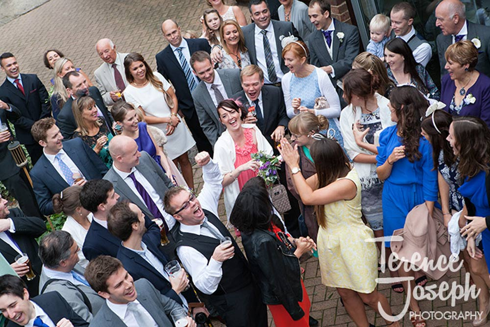 A wedding guests catches the brides flowers