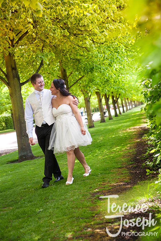 Couple walking through the park in Summer