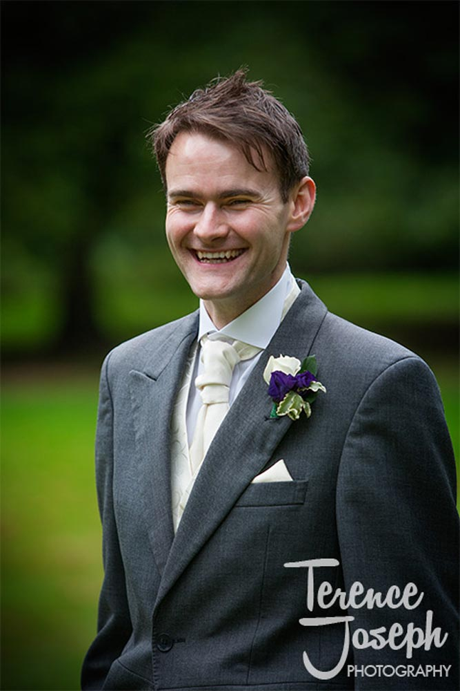 Groom laughs and enjoys himself