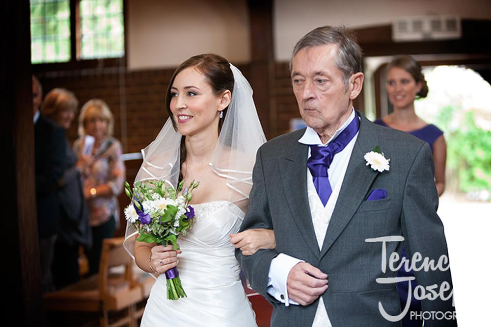 Bride and her father walk down the isle