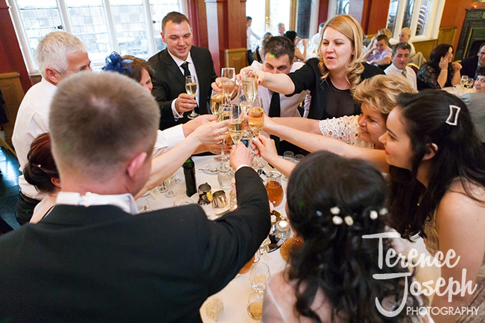 Bridal party celebrates with champagne