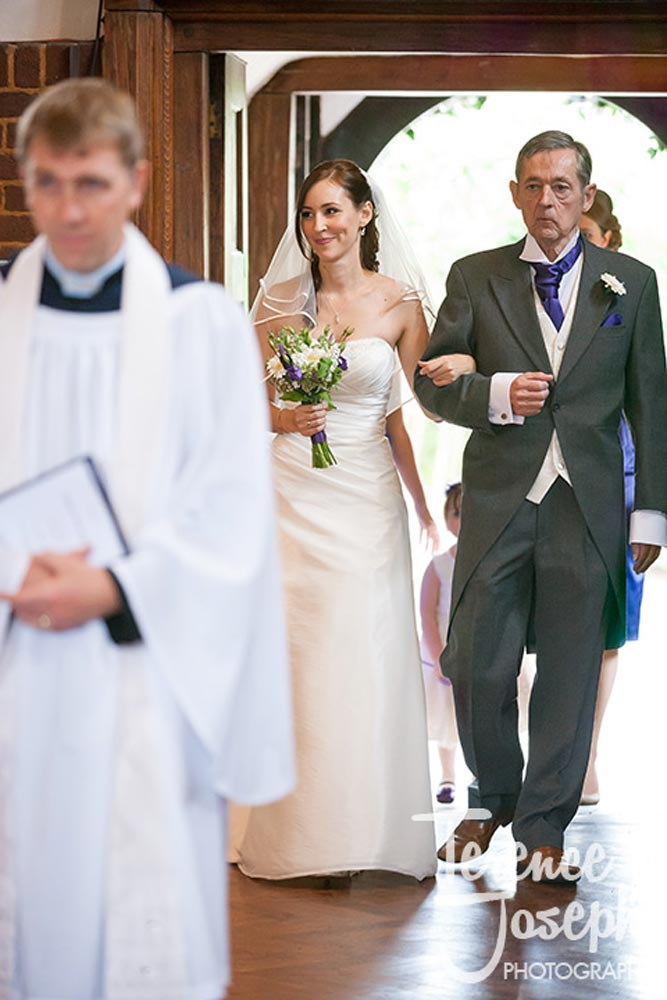 Bride and her father walk into the church