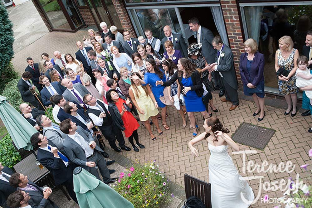 The bride throughs her bouquet