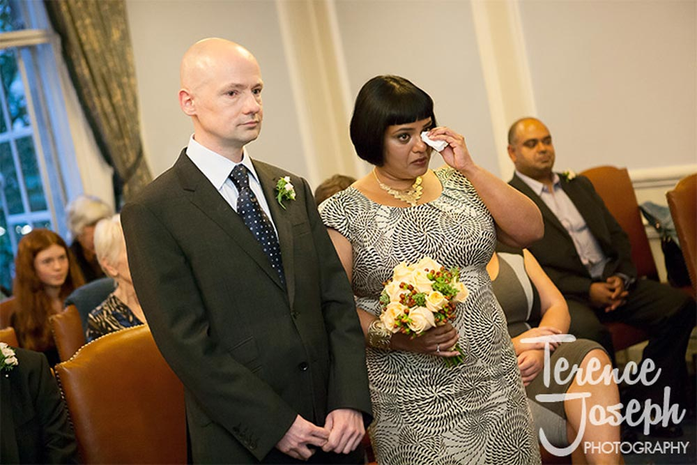 Bride cries during London Wedding Ceremony