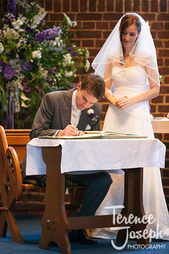 The signing of documents at church wedding