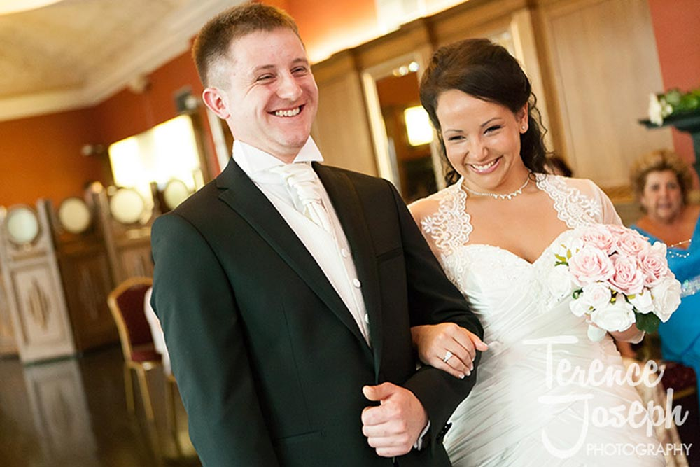 Bride and groom laugh happily lacey during their Ceremony in London