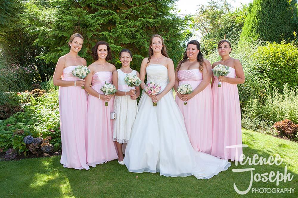 Bride and bridesmaids Summer garden photos