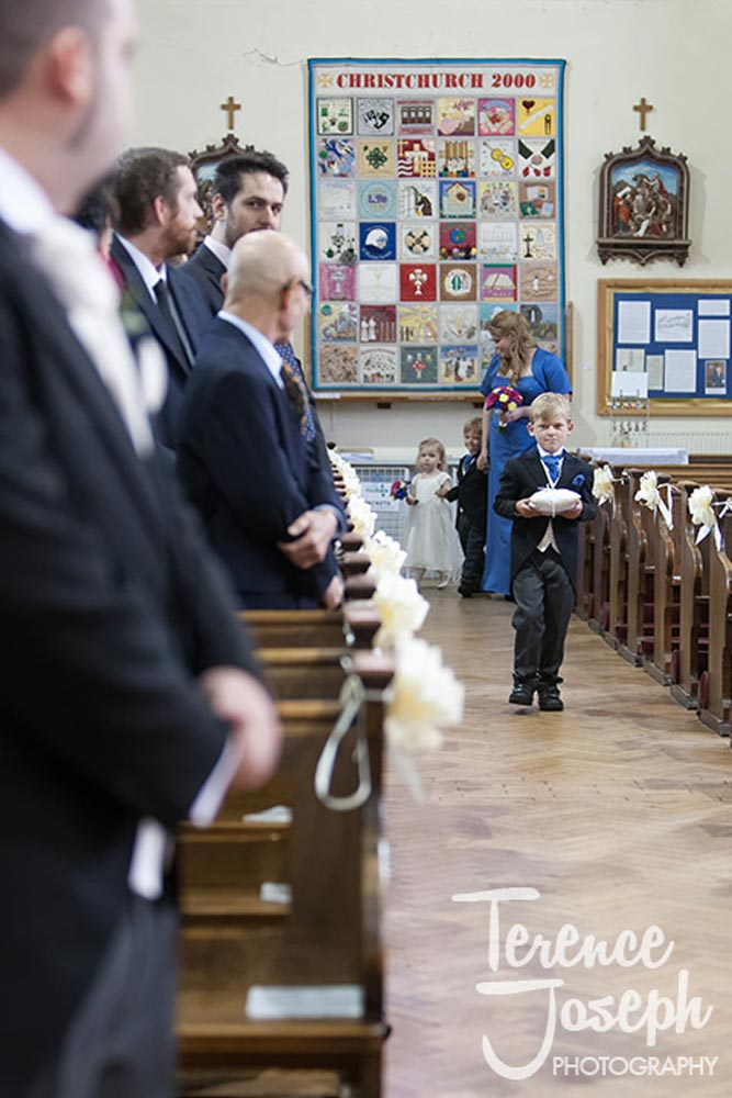 Ring bearer walks down the aisle in London