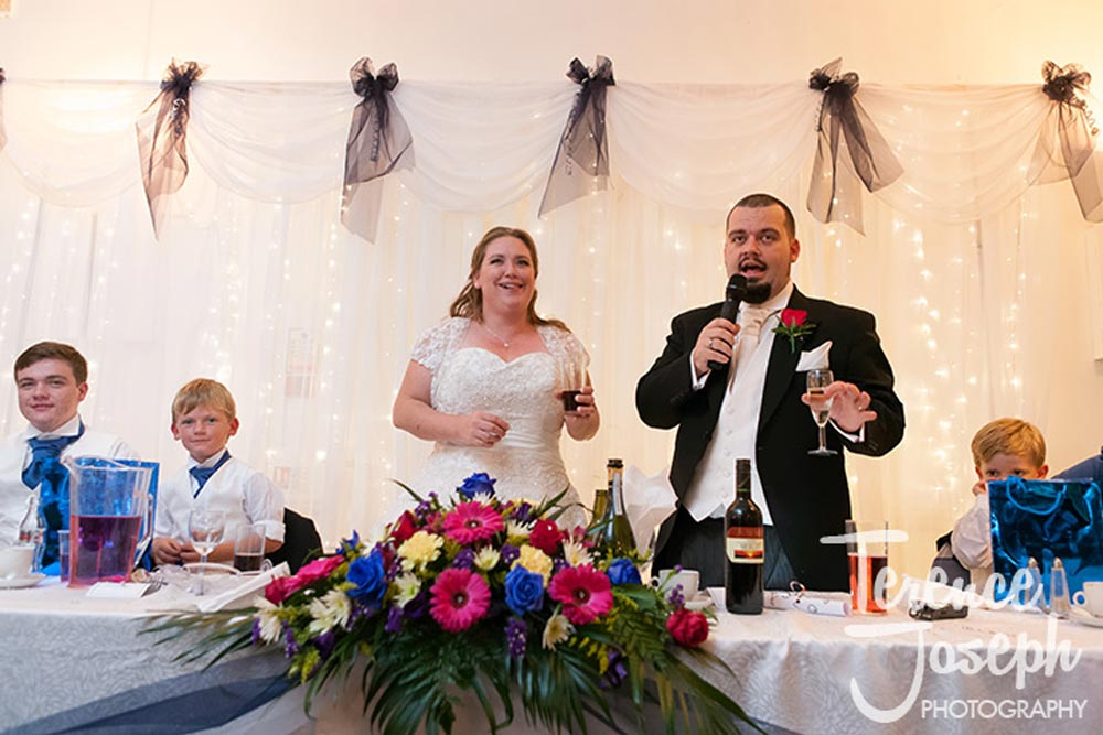 The bride and groom toast