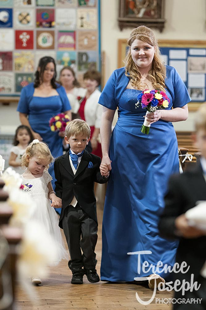 Page boy walks down the aisle