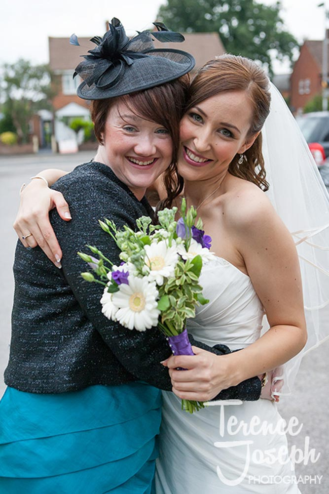 Bride embraces a friend outside the church