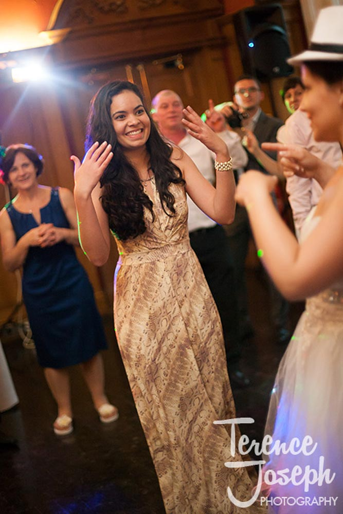 Bridesmaid has a great time at reception