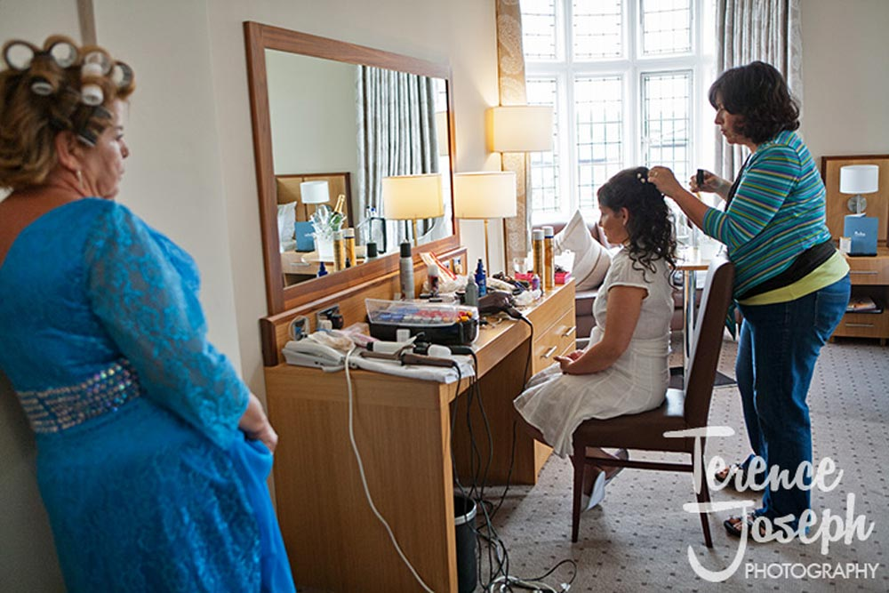 Relaxed mother looks as bride gets ready in Moran Hotel London