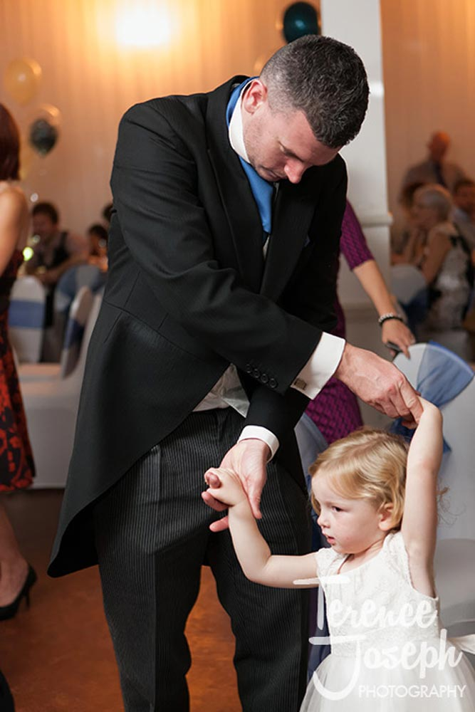 Lovely father looking after this child at a wedding