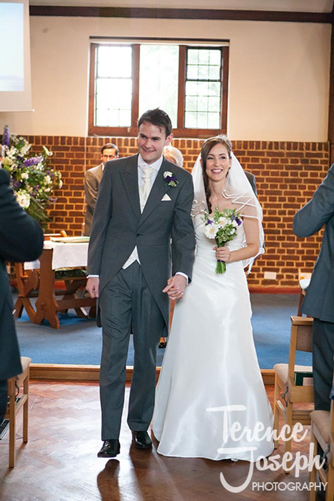 The new Mr and Mrs walk down aisle